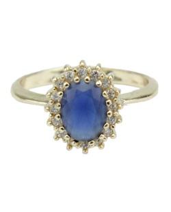 Anel de metal dourado com strass azul Cess