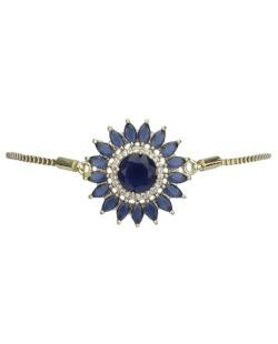 Pulseira de metal dourado com strass azul Stari