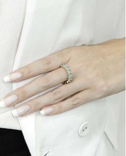 Anel de metal dourado com pedra azul claro Pétionvi