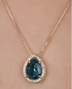 Colar de metal dourado com pedra fusion azul Thoys