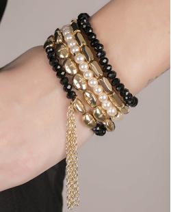 Kit de 5 pulseiras de acrílico dourado com preto Denver