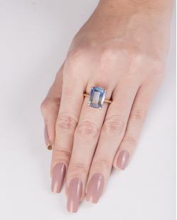 Anel de metal dourado com pedra rainbow azul Modric