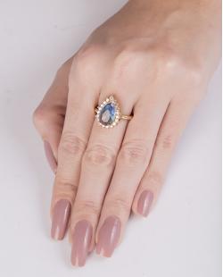 Anel de metal dourado com pedra rainbow azul Drake
