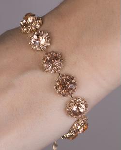 Pulseira de metal dourado com pedra rosé mone