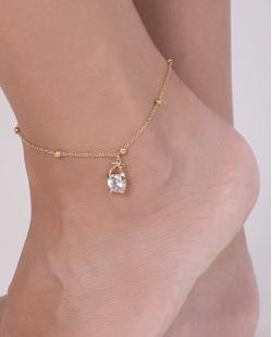 Tornozeleira de metal dourado com pedra cristal Dora