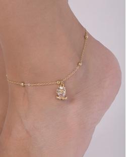 Tornozeleira de metal dourado com pedra cristal Dani