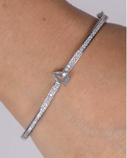 Bracelete de metal prateado com pedra azul e strass cristal drop