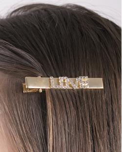Presilha de metal dourado com strass cristal love