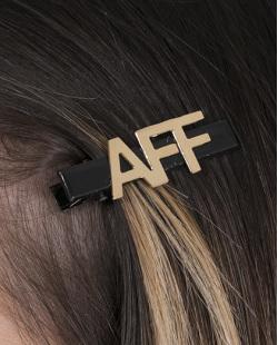 Presilha de metal preto e dourado Aff