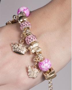 Pulseira de metal dourado com pedra rosa Juçara
