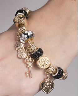 Pulseira de metal dourado com pedra preta Berenice