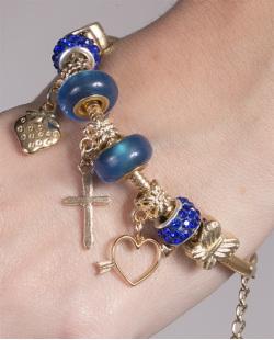 Pulseira de metal dourado com pedra azul Lorena