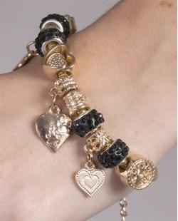 Pulseira de metal dourado com pedra preta Barbara