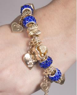 Pulseira de metal dourado com pedra azul Barbara