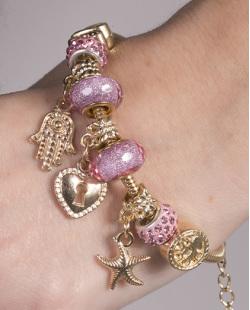Pulseira de metal dourado com pedra rosa Patricia