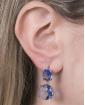 Brinco pequeno de metal prateado com pedra azul Palmira