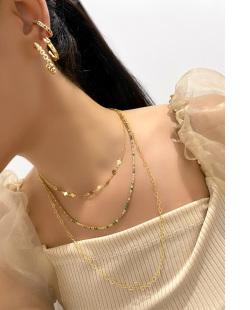 Mix de bijuterias douradas Nyta