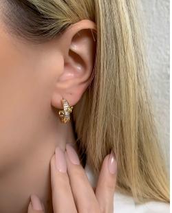 Argola dourada com pedra cristal Lenz
