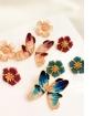 Brinco dourado borboleta esmaltada Torênia azul