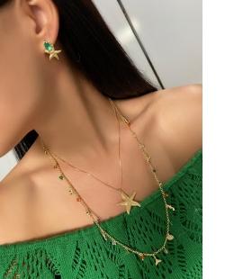 Brinco MB Semi joia dourado zircônia verde Estrela do Mar