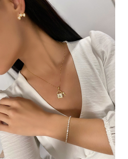 Pulseira MB Semi joia dourada cravejada zircônias cristal